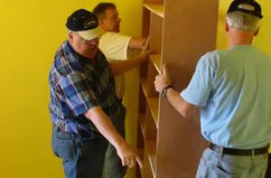 community_bob_michael_installing_shelves